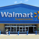 ETOBICOKE, CANADA - JULY 24: Walmart Supercentre entrance on July 24, 2013 in Etobicoke, Ontario, Canada. Walmart is an American multinational retail corporation that runs chains of large discount department stores. It is the world's third largest public corporation, according to the Fortune Global 500 list in 2012.