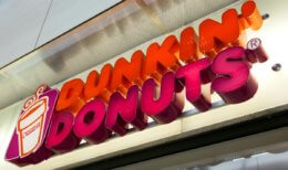Essen, Germany - September 1, 2011: Dunkin' Donuts sign at shop entrance. Dunkin' Donuts is an international doughnut and coffee retailer founded in 1950, headquartered in Canton, Massachusetts.