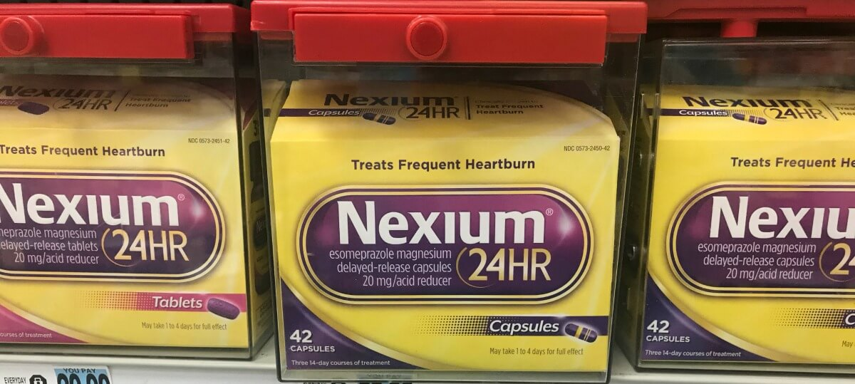 image relating to Nexium Coupons Printable named Fresh new $5/1 Nexium 24HR Coupon DealsLiving Abundant With Coupons®