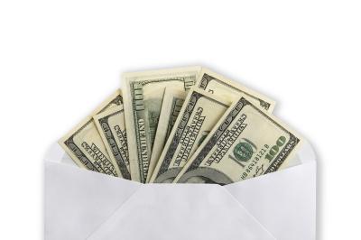 $100 banknotes in envelope